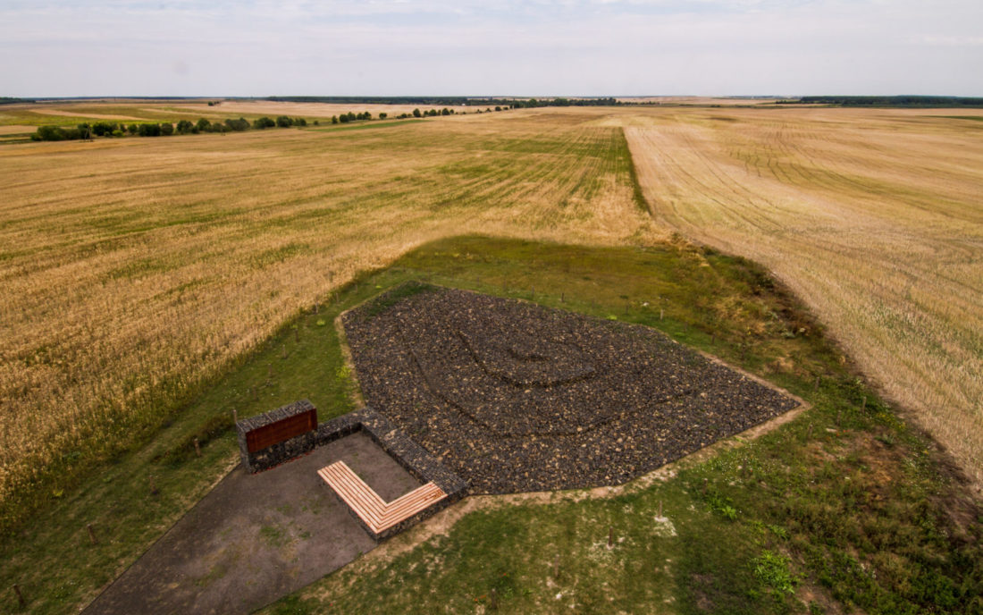 The memorial site is in the middle of a field, July 2015